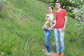 Attractive young couple enjoying a day in nature — Stock Photo