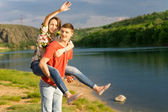 Young couple having a piggy back ride — Stock Photo