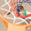 View through the net of a basketball shooter — Stock Photo #46964507