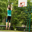 Skilled young basketball player shooting a goal — Stock Photo #46964737