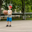 Cute athletic little boy playing basketball — Stock Photo #46964771