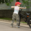 Cute macho little boy with his bicycle — Foto de Stock