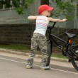 Cute macho little boy with his bicycle — ストック写真