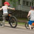 Two young boys playing on their bikes — Stock Photo #46964783
