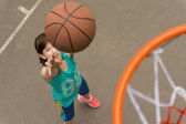 Teenage girl shooting for a goal in basketball — Stock Photo