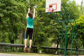 Skilled young basketball player shooting a goal — Stock Photo