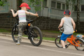 Two young boys playing on their bikes — Stock Photo