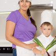 Mother teaching her young son to cook — Stock Photo