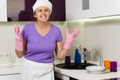 Frustrated cook wringing her hands in desperation — Stock Photo