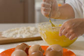Child mixing ingredients in a mixing bowl — Stock Photo