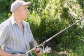 Contented senior fisherman — Stock Photo