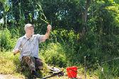 Handicapped angler enjoying a day fishing — Stock Photo
