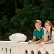 Happy young couple leaning on a balustrade — Stock Photo #49168675