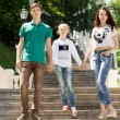 Young couple walking with a young girl — Stock Photo #49168723