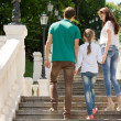 Young couple climbing steps with a little girl — Stock Photo #49168733