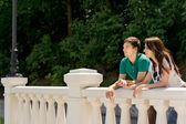 Young couple enjoying the view from a bridge — Stock Photo