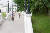 View from behind of cyclists descending steps — Stock Photo