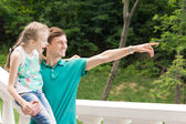 Young man pointing out something for his sister — Stock Photo