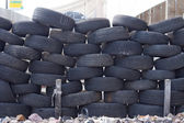 Old tires stacked to form a barricade — Stock Photo
