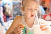 Young girl looking in disgust at her takeaway soda — Stock Photo