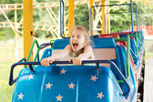 Funny girl screaming in the roller coaster — Stock Photo