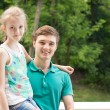 Handsome young man with his little sister — Stock Photo #49482877