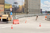 Cyclist corning off an overpass at speed — Stock Photo