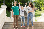 Young couple with their young sister — Stock Photo