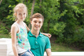 Handsome young man with his little sister — Stock Photo