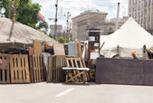 Barricade across a town street for a fair or race — Stock Photo