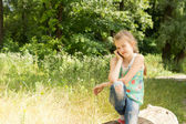 Young girl playing in woodland — Stock Photo