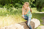 Bored girl having a call on the mobile phone — Stock Photo