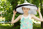 Young Pretty Mad Girl in Round Big White Hat — Stock Photo