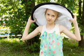 Attractive Little Girl Wearing Big Round Hat — Stock Photo