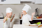 Two cute kids dressed up as chefs — Stock Photo