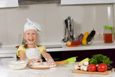 Cute young girl in the kitchen — Stock Photo