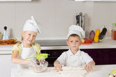 Adorable Kid Chefs Baking Something to Eat — Stock Photo