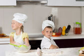 Cute Kids in Chefs Attire in Kitchen — Stock Photo