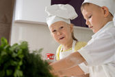Two Cute Young Home Chefs — Stock Photo