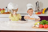 Two Very Young Chefs Making Food While Talking — Stock Photo