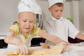 Cute Young Chefs Busy Preparing Food — Stock Photo