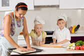 Mother Helping Chef Kids Making Food — Stock Photo