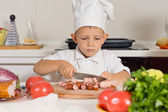 Little boy training to be a chef — Stock Photo