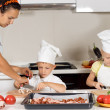 Mother teaching her children to cook — Stock Photo #51130005