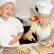 Cute Little Chefs Slicing Pizza Ingredients — Stock Photo #51130075
