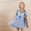 Постер, плакат: Beautiful playful little girl with a happy smile