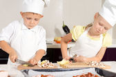 Kid Chefs Slicing Ingredients on Chopping Board — Stock Photo
