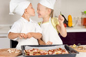 Cute Little Chef Kissing her Chef Sister — Stock Photo