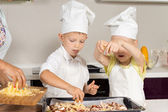 Cute Little Kids Putting Cheese on Pizza — Stock Photo