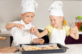 Cute Little Kid Chefs Putting Ingredients on Pizza — Stock Photo